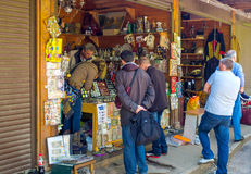 The numismatic shop in Izmailovsky market. MOSCOW, RUSSIA - MAY 10, 2015: The tourists at the numismatic shop of Izmailovsky market choose old coins, stamps Stock Images