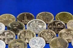 Numismatica o collezionismo di monete, studi la storia dell'invenzione e circolazione monetaria in paesi differenti del mondo e immagini stock
