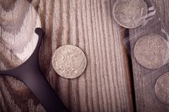 Numismatics, collect old coins. Top view. Silver coins close up on the table royalty free stock images