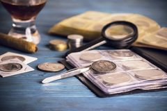 Collecting old  coins. Numismatics, collecting old valuable coins Stock Photo
