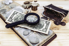Numismatist. Collecting valuable old money numismatist Royalty Free Stock Images