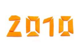 Nummer 2010 van pompoen op wit Stock Afbeeldingen