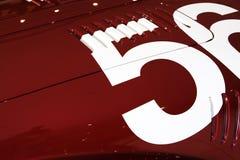 Nummer 56 van rode auto Royalty-vrije Stock Afbeeldingen