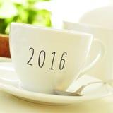 Nummer 2016, als nieuw jaar, op een kop van koffie of thee Stock Foto's