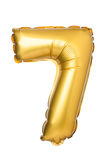 nummer 7 av den guld- ballongen Arkivfoton