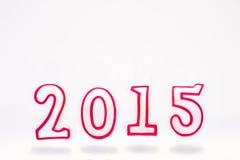 Nummer 2015 die op witte achtergrond vliegen Stock Afbeelding