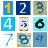 Nummer ett till nio i blått Arkivbild