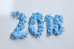 Nummer för flytandeblått 2018 med droppar på vit bakgrund Royaltyfri Foto