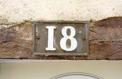 nummer för hus 18 Arkivfoto