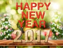 Nummer för lyckligt nytt år 2017 på brun Wood tabellöverkant med abstrakt begrepp Arkivbilder