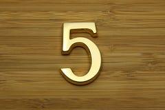 Nummer fem, nummer för husadressplatta Arkivbilder