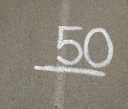 Nummer 50 femtio på grå bakgrund Royaltyfri Bild
