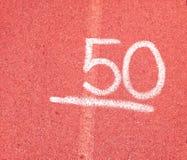 Nummer 50 femtio på röd bakgrund Royaltyfria Bilder