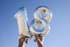 Nummer-formade ballonger som bildar numret 18 Arkivbilder