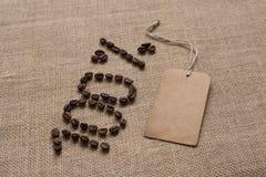 100% nummer från kaffebönor och etikett Arkivbild