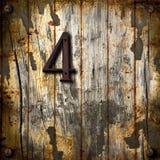 Nummer fyra på träbakgrund Arkivbild