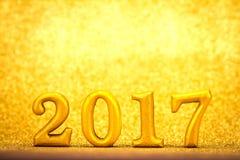 Nummer 2017 geplaatst op gouden elegante glamourachtergrond voor nieuwe ye Stock Afbeeldingen