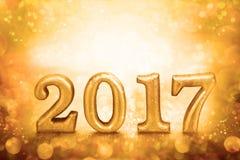 Nummer 2017 geplaatst op gouden elegante glamourachtergrond voor nieuwe ye Stock Foto's