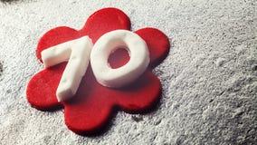 Nummer 70 gjorde av fondanten Arkivbild