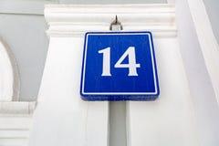 Nummer 14 mot en blå bakgrund Royaltyfria Bilder