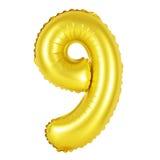 Nummer 9 nio från guld- ballonger Arkivfoton