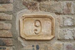 Nummer nio på en vägg Royaltyfri Bild