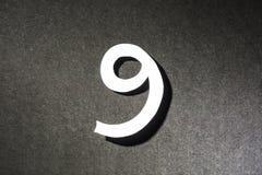 Nummer nio på grå bakgrund Arkivfoton