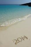 Nummer 2014 op het zandige strand Stock Foto