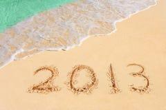 Nummer 2013 på strand royaltyfri bild