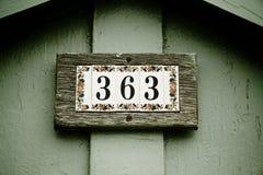 Nummer på tegelplattor Arkivbilder