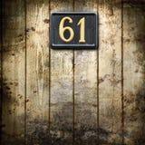 Nummer 61 på träbakgrund Fotografering för Bildbyråer