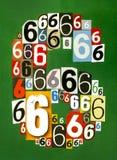 Nummer sex gjorde från nummer som klipper från tidskrifter på gräsplanbac Fotografering för Bildbyråer