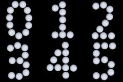 Nummer som dras med golfbollar Arkivbilder