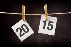 Nummer 2015 som skrivs ut på papper lyckligt nytt år för begrepp Royaltyfria Foton