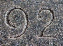Nummer 92 som snidas i sten Royaltyfri Fotografi