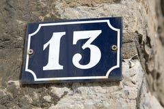 Nummer tretton på väggen Royaltyfri Bild
