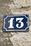 Nummer tretton på väggen Royaltyfria Foton