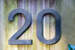 Nummer 20 van ijzer op hout Stock Afbeelding