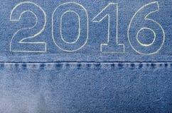 Nummer 2016 van krijtcontour op de achtergrond van de jeans CH Stock Foto