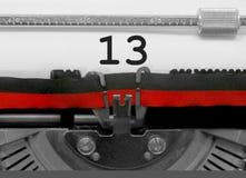 Nummer 13 vid den gamla skrivmaskinen på vitbok Fotografering för Bildbyråer