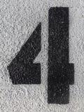 Nummer vier op asfalt Stock Afbeelding