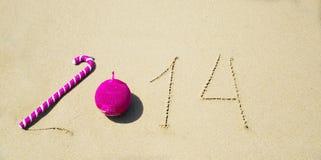 Nummerieren Sie 2014 auf dem Sand - Feiertagskonzept Lizenzfreie Stockfotografie