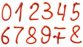 Nummersymboler som göras från ketchupsirap Arkivfoto