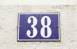 Numnero thirty eight in the wall of a house Stock Photography