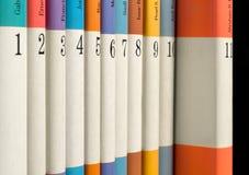 Numrerade böcker i rad Arkivbilder