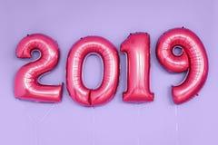Numrerar nytt år 2019 för jul ballonger beröm ferie arkivbilder