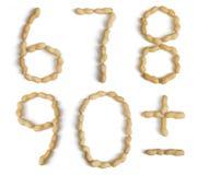 Numrerar och symboler som göras av jordnötter Royaltyfri Bild