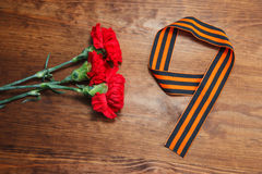 Numrerar röd blomma tre och 9 på en träbakgrund Bild för selektiv fokus Fotografering för Bildbyråer