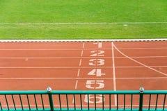 Numrerat rinnande spår, startande position Fotografering för Bildbyråer
