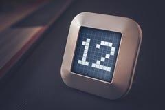 Numret 12 på en Digital kalender, termostat eller tidmätare Arkivbilder
